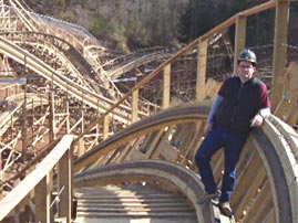 Man Standing on Roller Coaster Track