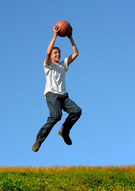 Boy Leaping with Basketball