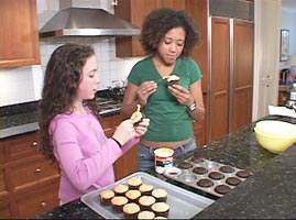 Two Girls Frosting Cupcakes