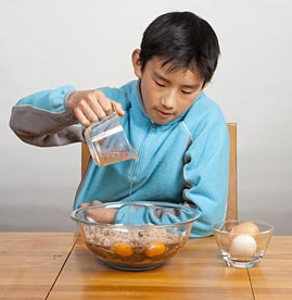 Boy Pouring Cooking Oil
