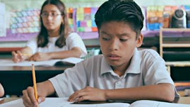 Moises Looking at His Math Book
