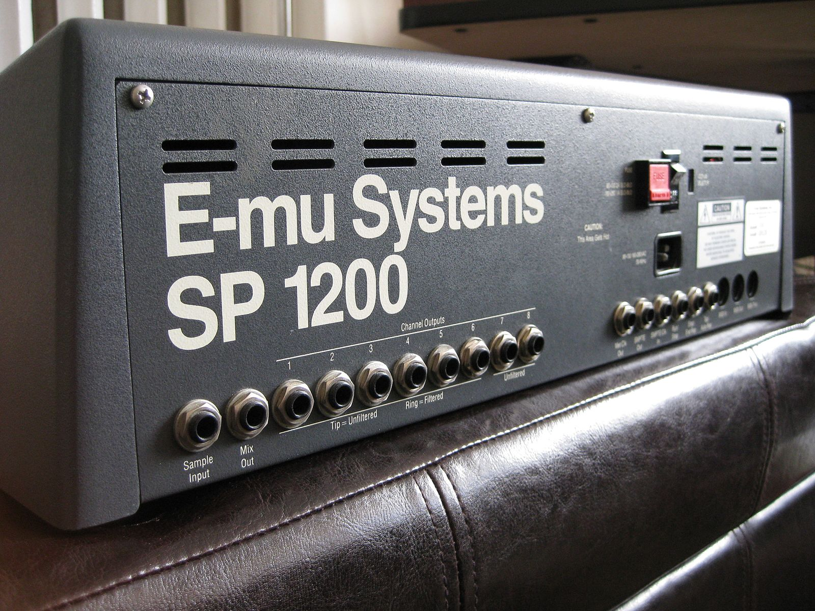 The back panel of an E-Mu SP-1200 digital sampler.